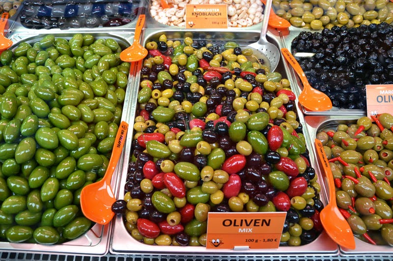 Olives and other specialties at the Naschmarkt market in Vienna, Austria