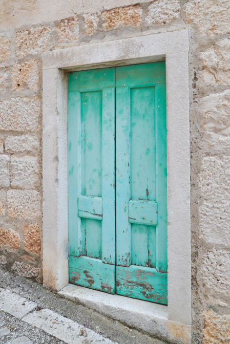 Beautiful turquoise door in the village of Sumartin on the Croatian island of Brač