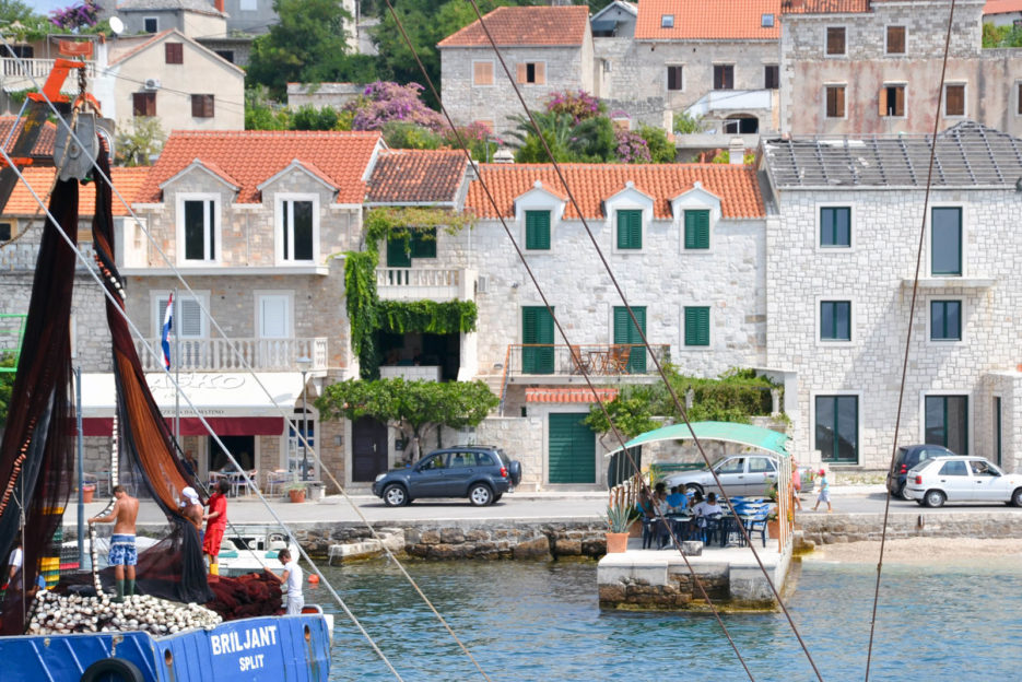 Fishermen disembarking nets in the port of Sumartin on the island of Brac, Croatia