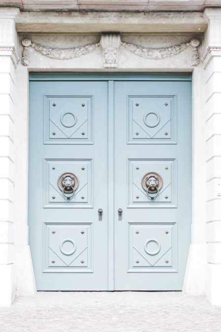A blue door of Buda Castle, Budapest, Hungary - Epepa Travel Blog