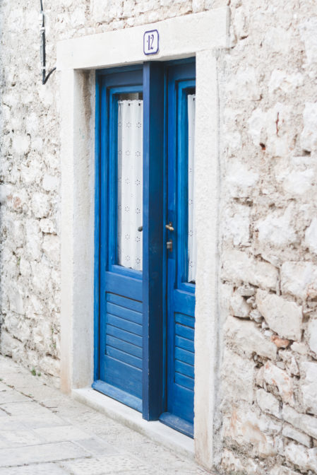 Blue door in Stari Grad, Croatia - from travel blog: https://epepa.eu/