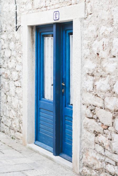 Blue door in Stari Grad, Croatia - from travel blog: https://epepa.eu/