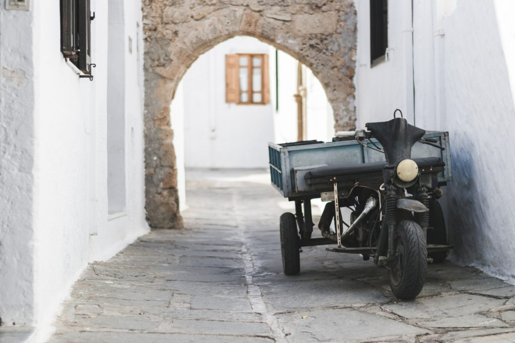 A moped in one of the narrow streets of the Greek town of Lindos, Rhodes - from travel blog: http://Epepa.eu