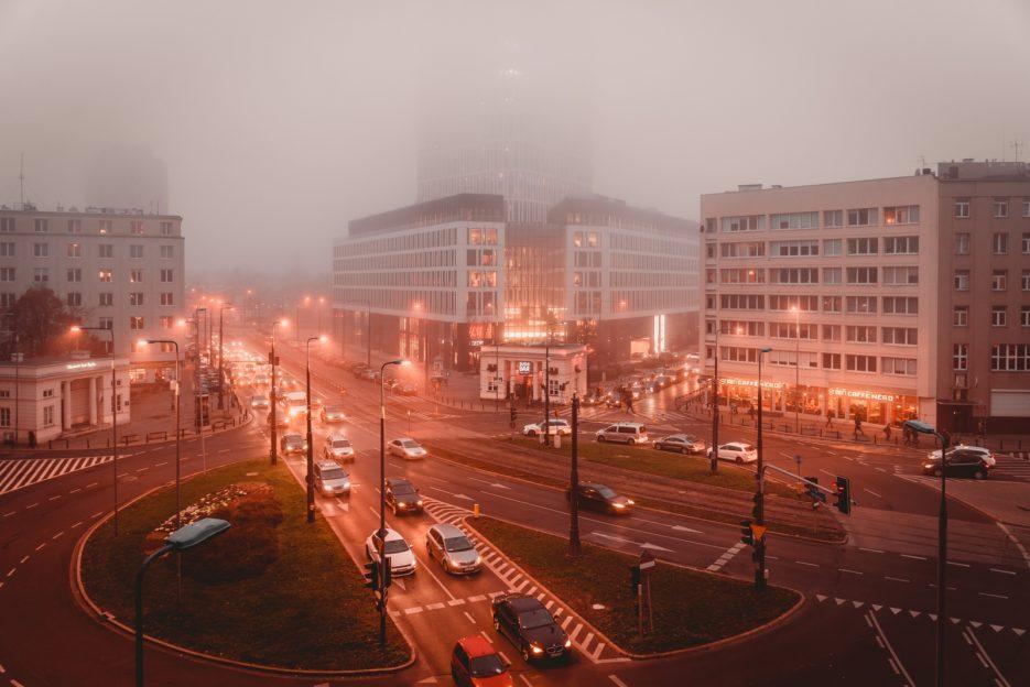 Plac Unii Lubelskiej on a misty autumn evening, Warsaw, Poland