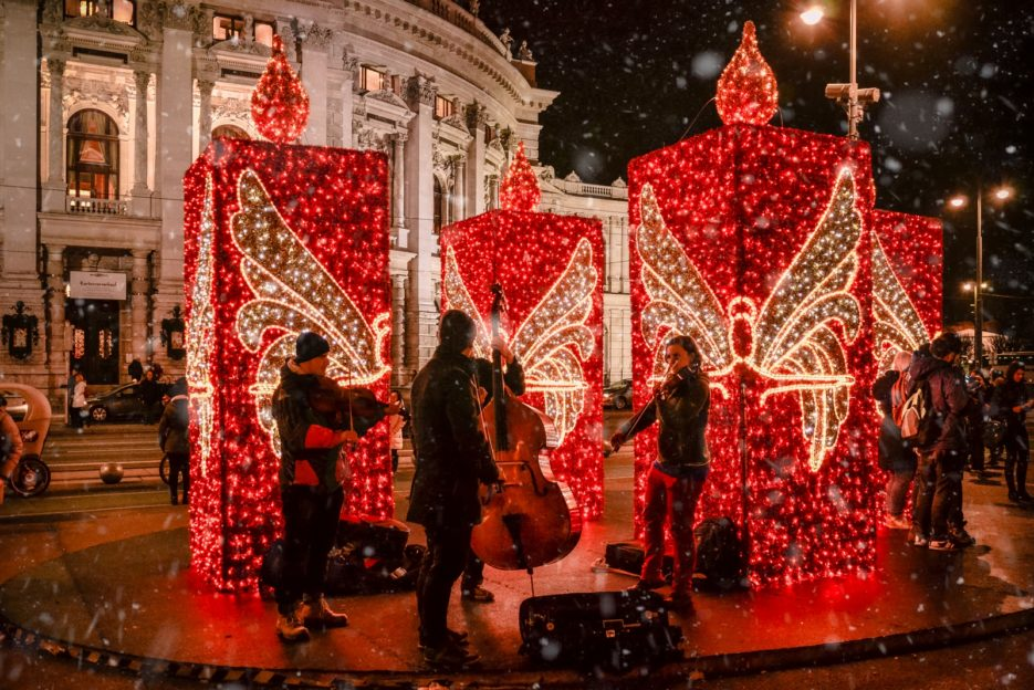 The musicians playing Christmas songs in front of the Burgtheater in Vienna, Austria