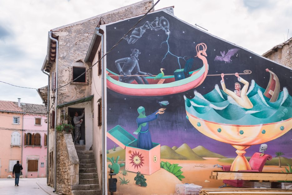A large colorful mural in the heart of the old town of Vodnjan, Croatia