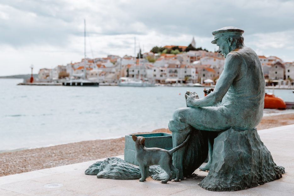 The statue of the fisherman with a cat in Primosten, Croatia
