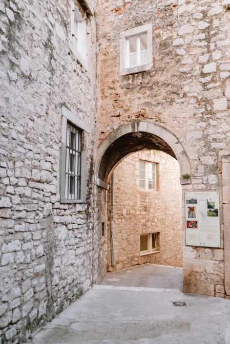 Narrow streets and historical stone houses in the old town of Šibenik, Croatia