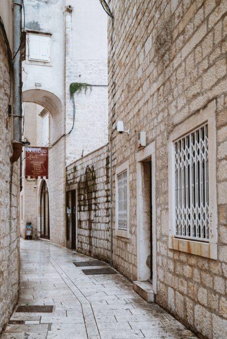 Narrow streets in the old town of Trogir, one of the must-see places Croatia