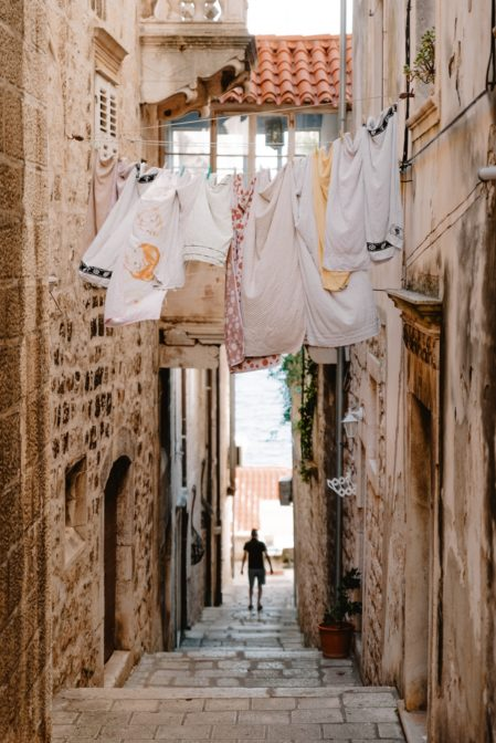 Laundry drying in the narrow street of Korčula Old Town, Croatia
