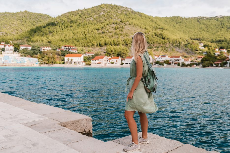 Travel blogger looking at the village and beach of Žuljana, Croatia