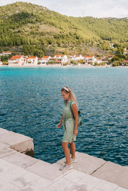 Strolling along the breakwater in the port of Žuljana, Croatia