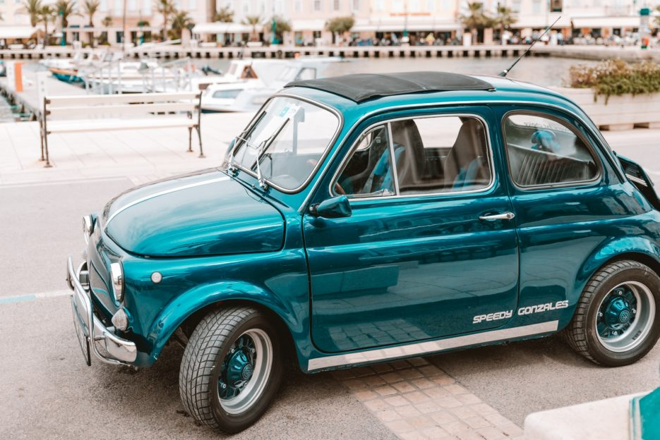A vintage car in the port of Mali Lošinj, Croatia