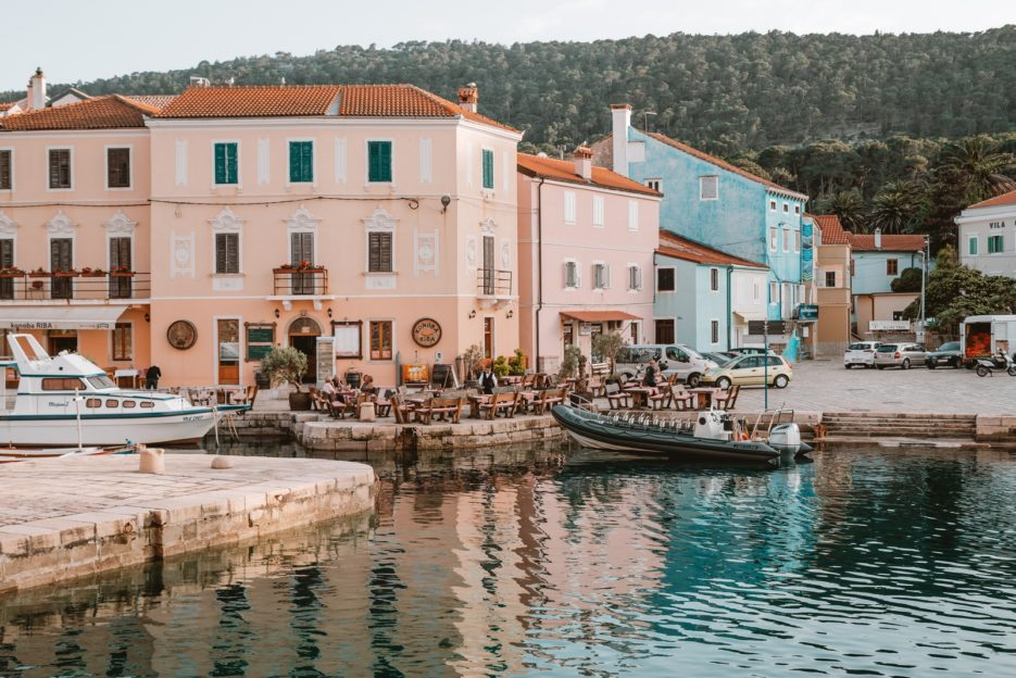 The Blue World Institute building and boat for dolphin-watching tours in Veli Lošinj, Croatia